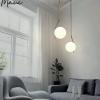 colgante diseño esfera desplazada metal adorno cuero maui acb iluminación electricidad-aranda-lamparas-almeria-