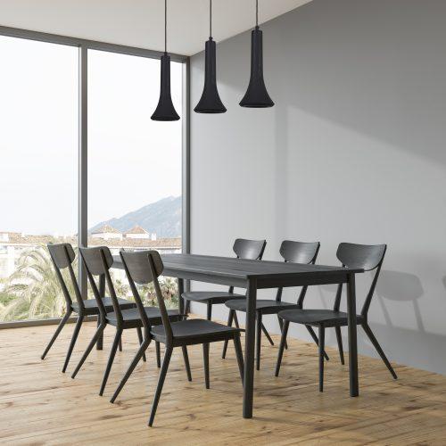 Dark gray dining table in a gray room corner